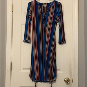Knee length, bright colored dress with pockets